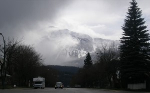 mountain looms over Revelstoke, British Columbia, on a rainy day