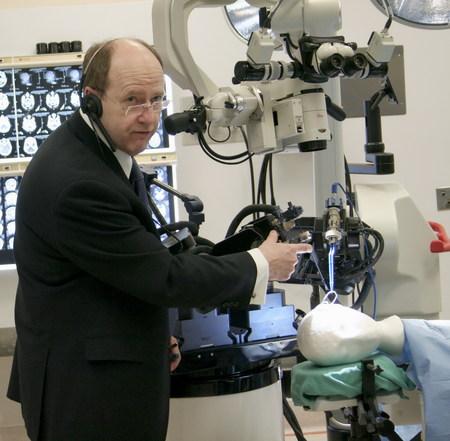 Dr. Garnette Sutherland demonstrates MRI-compatible NeuroArm